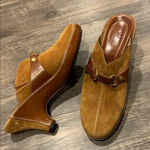 Cole Haan sued and leather mules